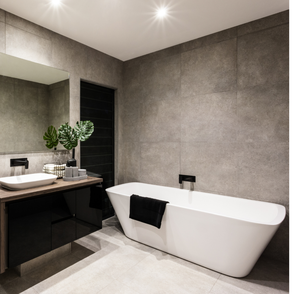 Portrait shot of a luxurious and stylish bathroom with a minimalist design for a sophisticated Sydney home by Renovahouse.