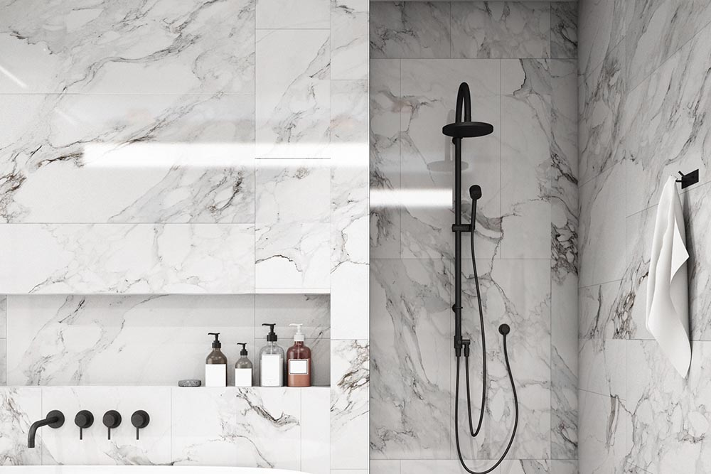 This bathroom by Renovahouse features a marble finish with a black vein on a white tile. very sophisticated and elegant bathroom in Sydney NSW Australia
