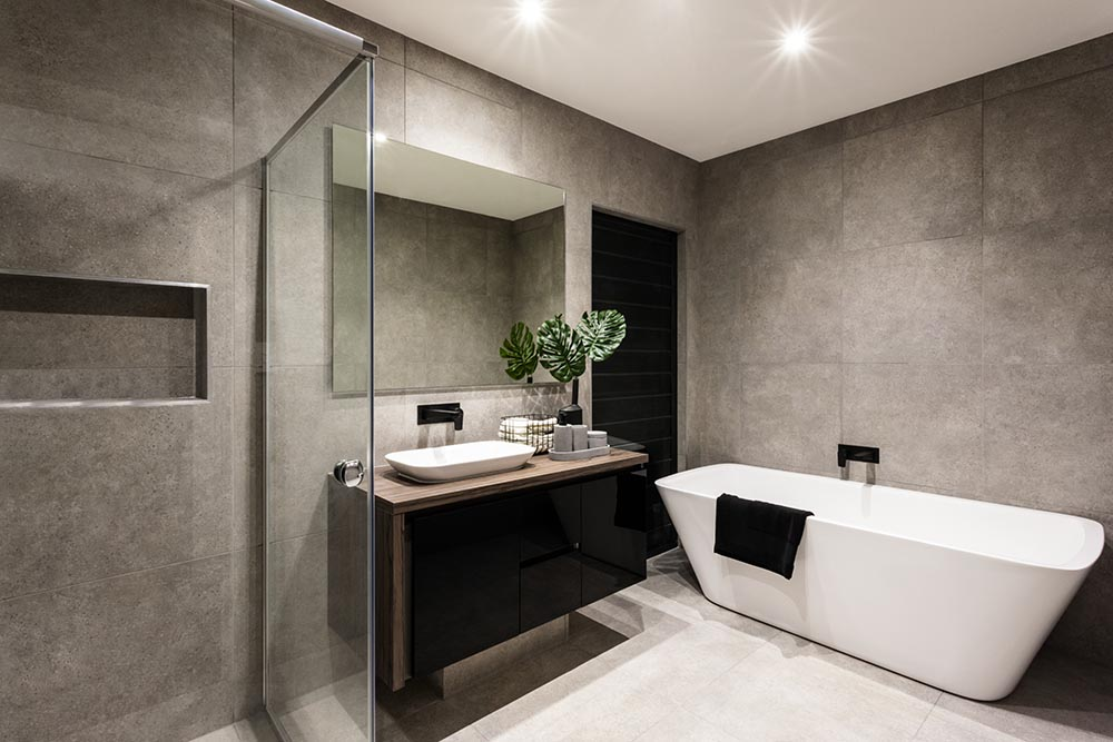 Modern bathroom with great matte tiles free standing bathtub and elegant vanity plus shower area and bathtub