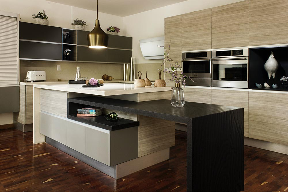 This luxury kitchen cabinetry by Renovahouse features a horizontal grain with an exquisite tiered island bench styled beautifully for a modern Sydney home
