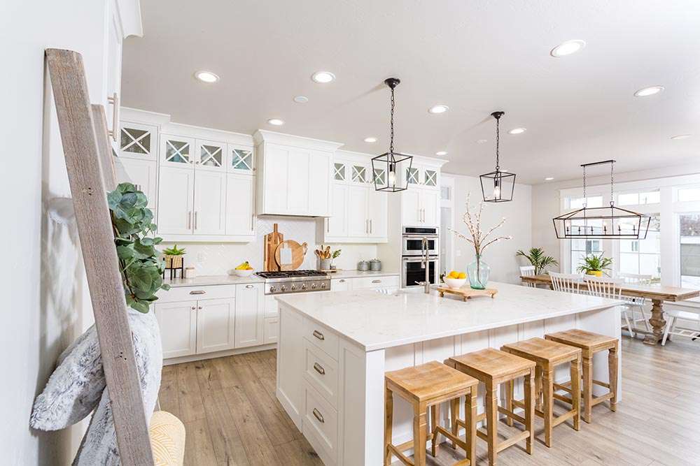 Wonderful modern White Farmhouse style Sydney Kitchen by Renovahouse with a huge Island bench top and stylish pendant lights