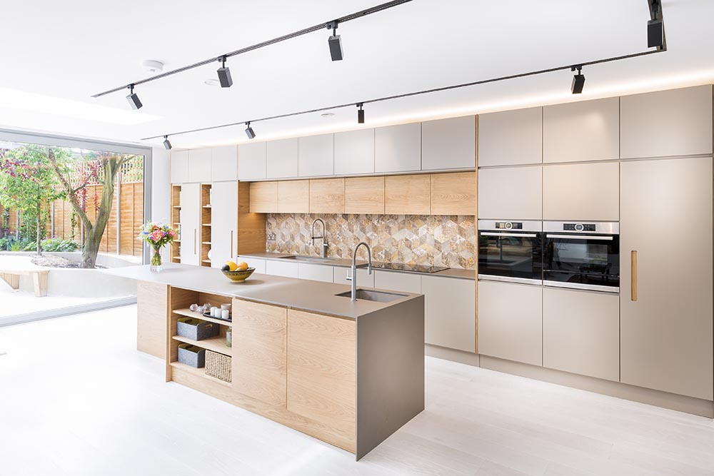 Beautiful timber cabinetry in this luxury sydney kitchen from Renovahouse with unique feature tiled splash back and wall ovens